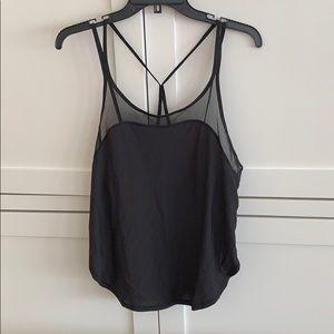 Never worn black Lululemon workout top - size 6